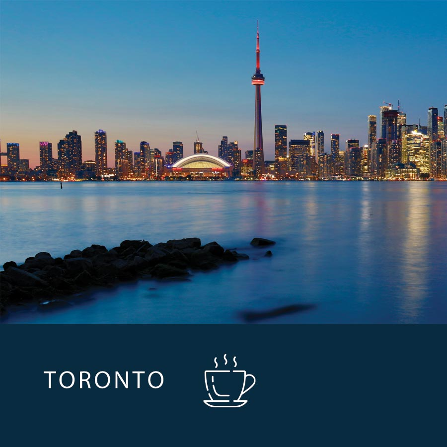 The gorgeous Toronto skyline in the early morning, with the power breakfast coffee icon at the bottom.